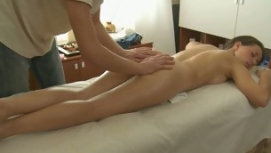 Charming masseur is plowing inviting hottie's cunt wildly